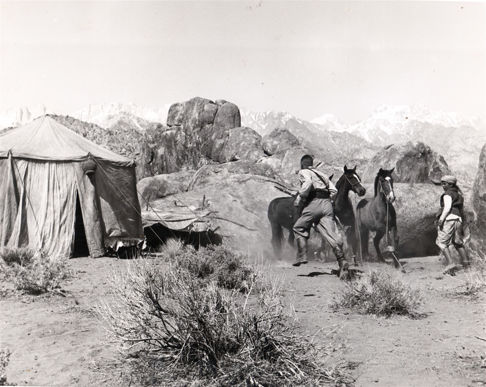 An aging Errol Flynn runs in this scene of a campsite located in what is called Ruiz Hill.
