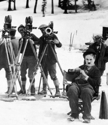 Director Chaplin oversees the shooting of some scenes in the snow on Donner in April.