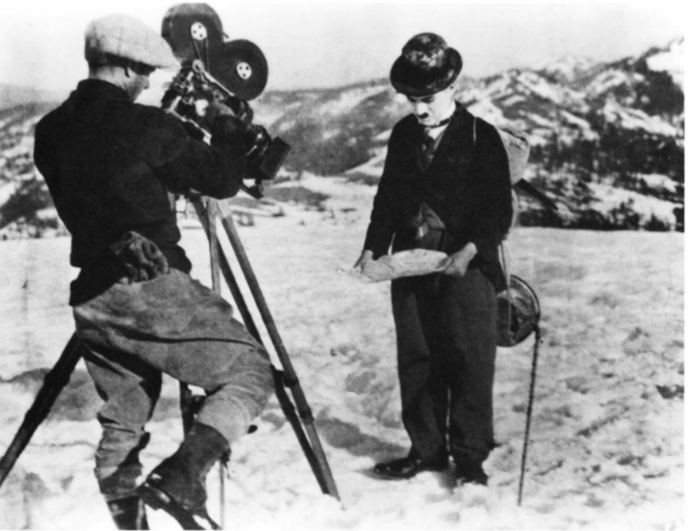 Charlie Chaplin before the camera near Donner Summit.