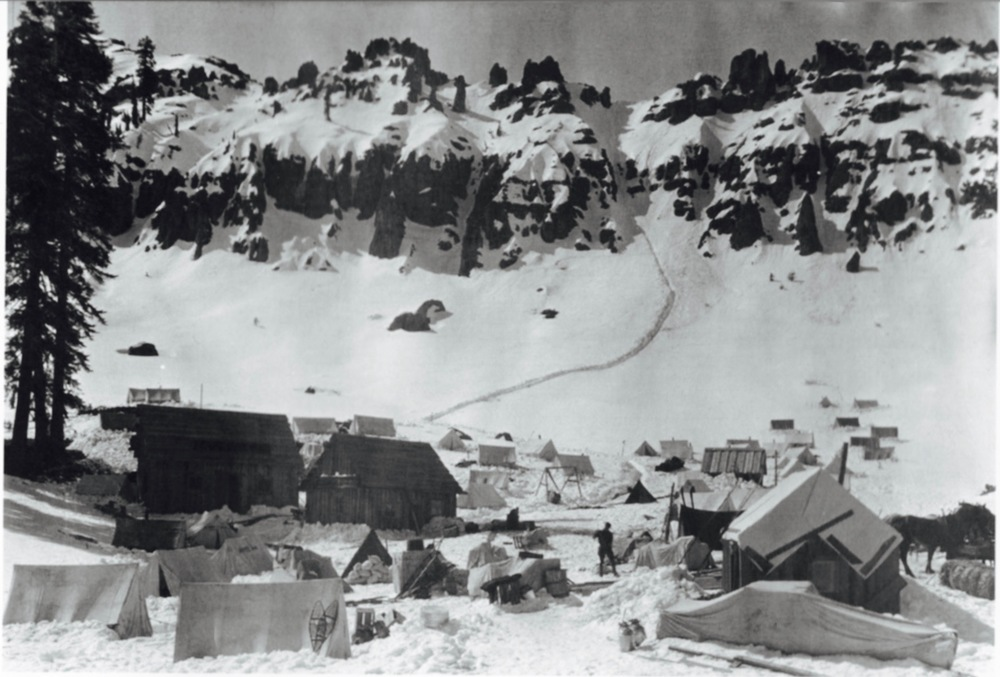 "The Totherow family retraced the famous path Grandfather Rollie shot of the men on ""Chilkoot Pass but  on Donner Summit."