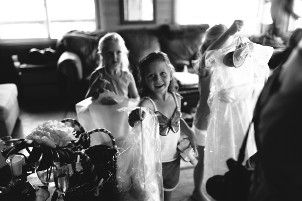 flower girls getting their dresses on.