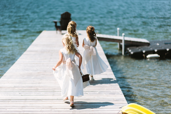 flower girls on dock at cottage wedding in parry sound, ontario.