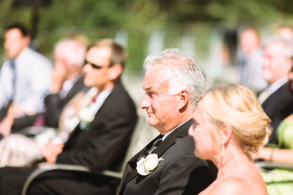 father of the bride watching wedding ceremony at stockey centre