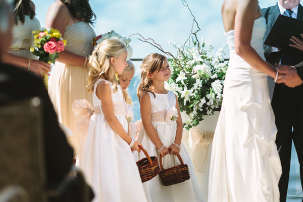flower girls watching wedding ceremony