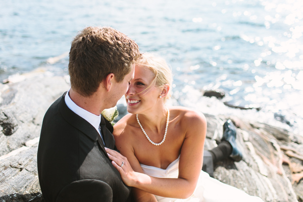couple sitting on rocks parry sound wedding.