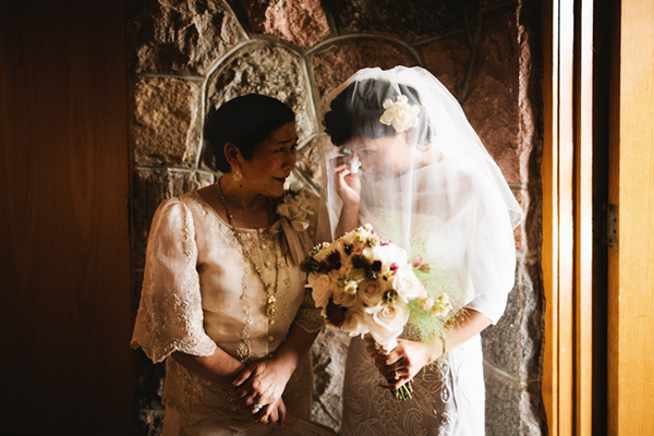 bride and mother sharing a tear before ceremony