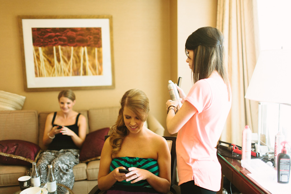 bride getting happy text message on wedding day