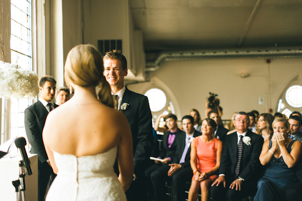 groom looks lovingly at bride in urban Toronto wedding