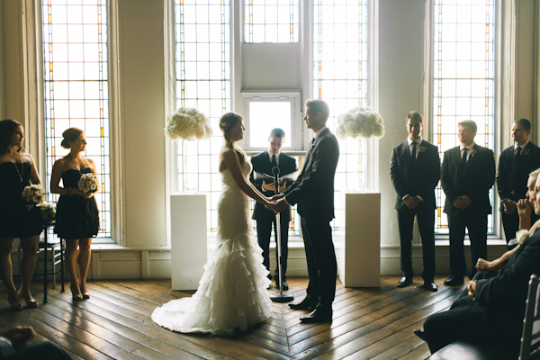 wide photograph of wedding ceremony at historic church wedding