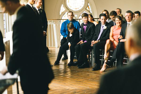 bored groomsmen at wedding