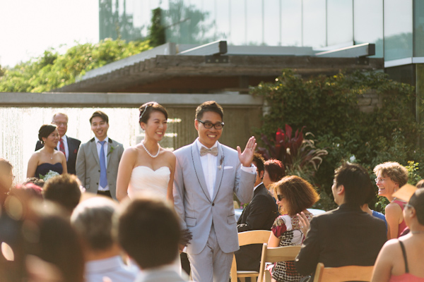 photo of walking back down the aisle at toronto botanical gardens wedding.