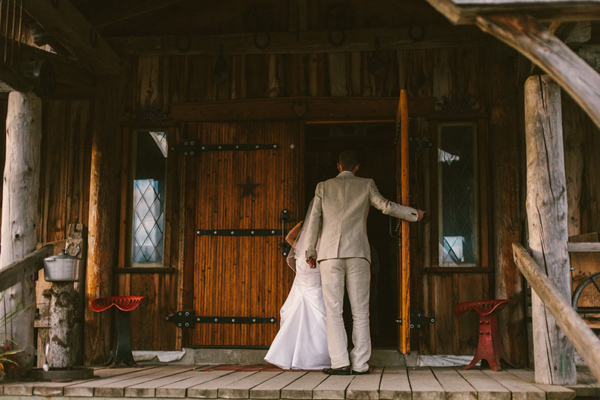bride and groom heading into wedding reception at purple hill country music hall wedding