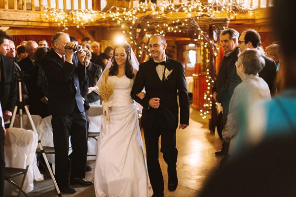 london wedding bride walks down the aisle