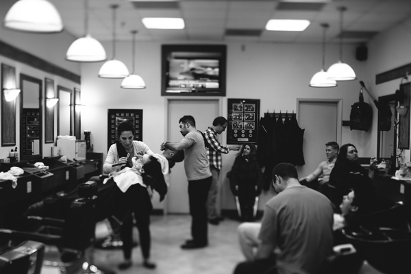 wide angle photograph of wedding party in barbers shop