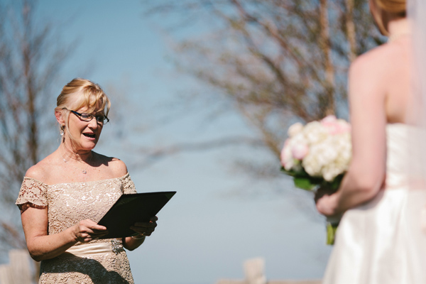 mother's reading at wedding ceremony in coolingwood ontario photograph