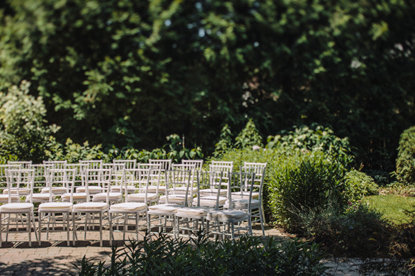 white chairs in ontario backyard wedding