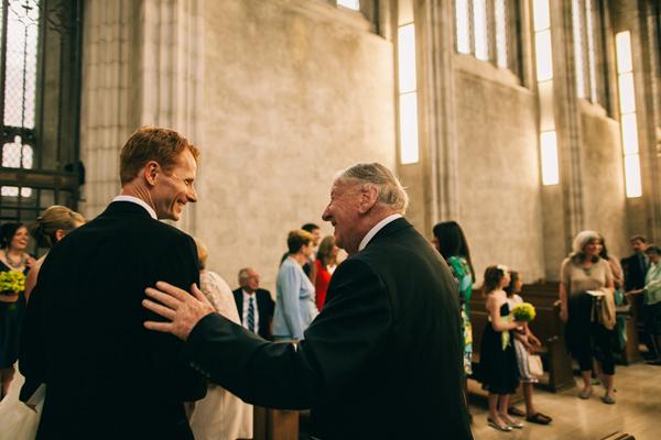 guests congratulate groom at wedding
