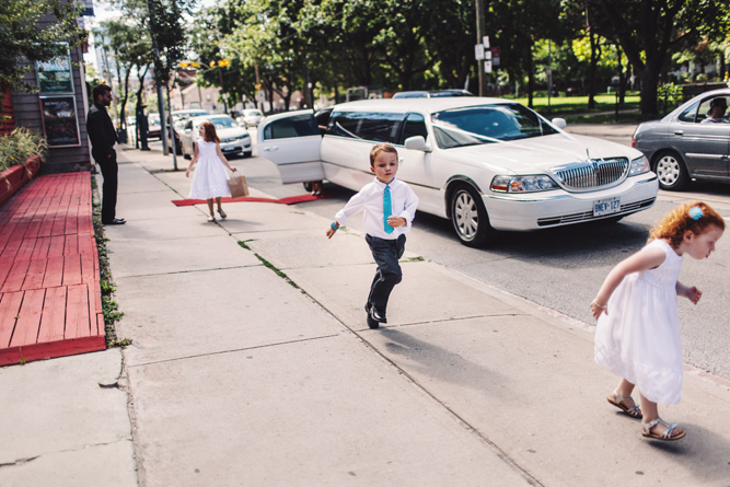 ring bearer with blue tie at wedding