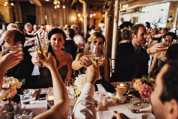 cheers, photojournalism shot at wedding