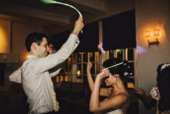 glowsticks on dance floor at wedding