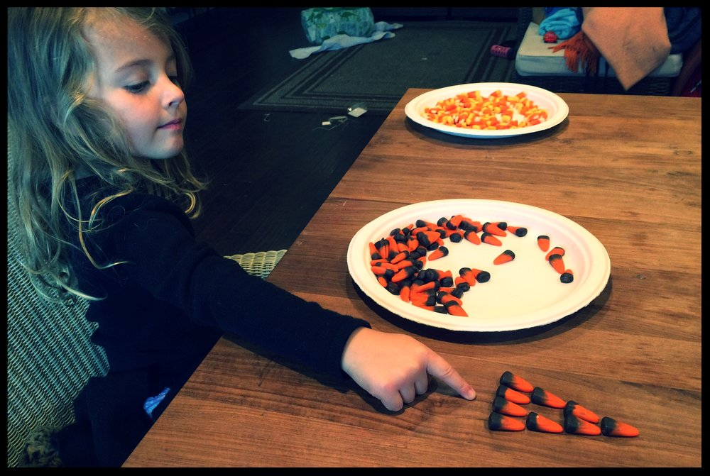 Making triangles out of candy corn is a super fun way to play and learn!