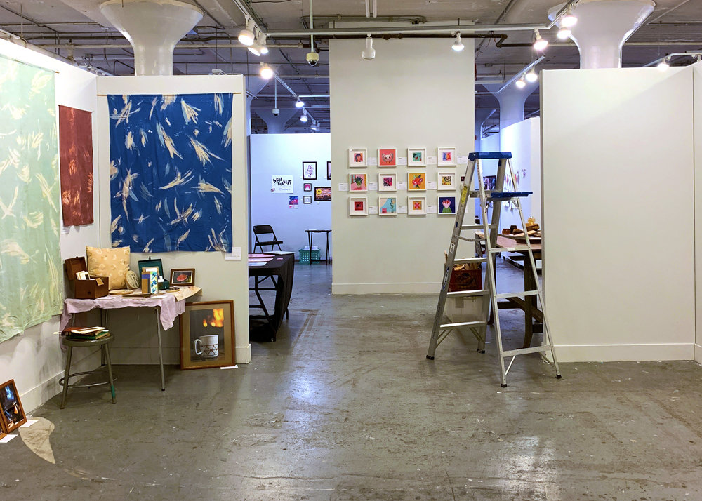 Artists set up their spaces for the MIAD Holiday Sale