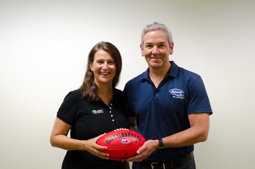 Disability Sports Australia CEO Jenni Cole and Invacare Asia Pacific's Vice President and General Manager Geoff Purtill.