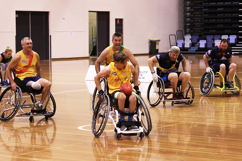 Brodie Healy competing at the 2017 Wheelchair Aussie Rules Nationals against RSL Active.
