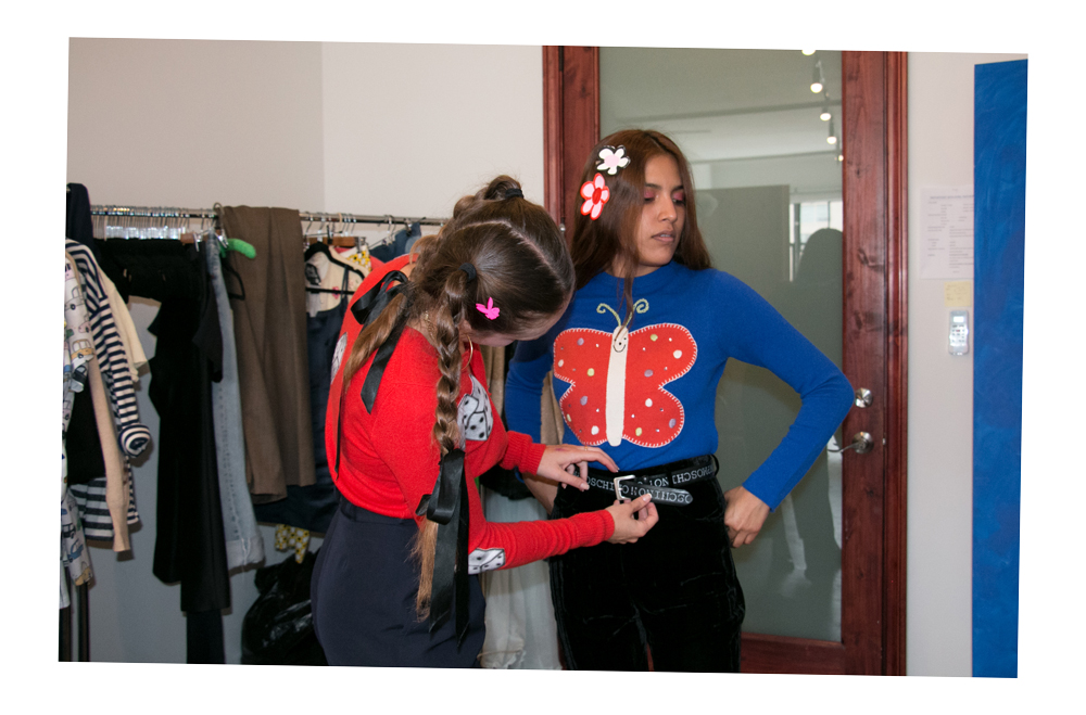 keely wears an old school gentle thrills airbrushed appliqué cardigan, chelsea wears one of the new spring one of a kind sweaters