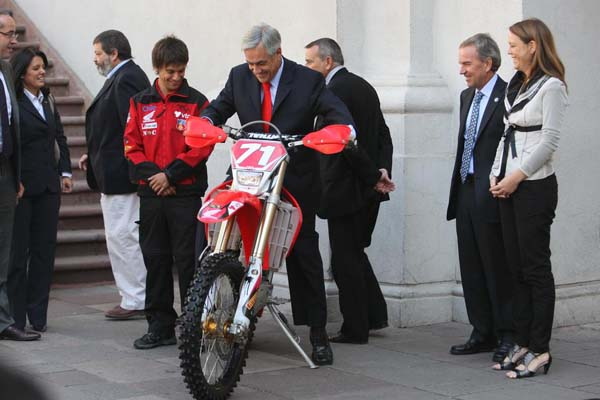 Special Ceremony with the President of Chile on Felipe's Pivot Pegz equipped Race Bike.