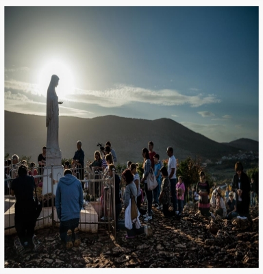 people Kneeling to mary statue