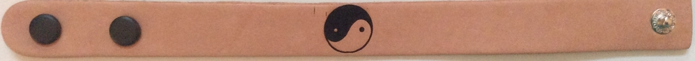 A Yin-&-Yang engraved bracelet, with some minor errors in the top left corner