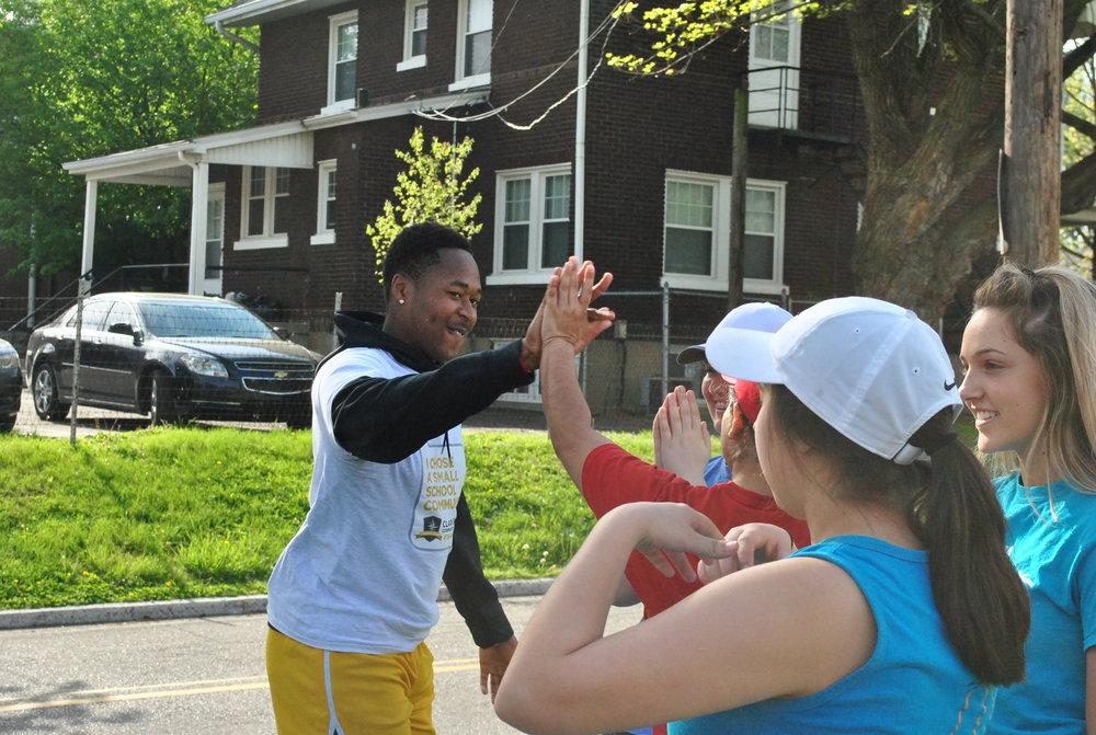 Volunteers High Fiving.JPG