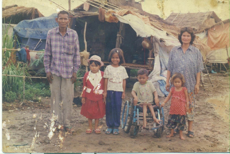 Longdy's family, Longdy is in the wheelchair.