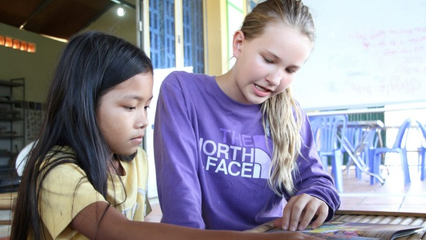 Nadia Winthrop, 11, volunteers teaching English once a week to kids living in a Phnom Penh slum