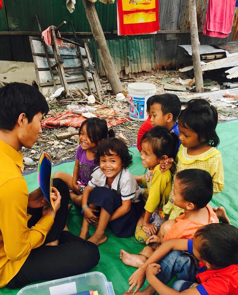 reading with book tuktuk.jpg