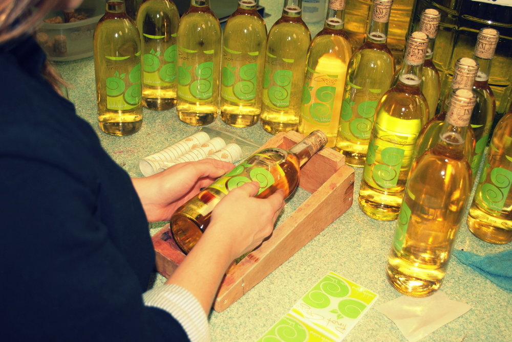 Labeling bottles by hand