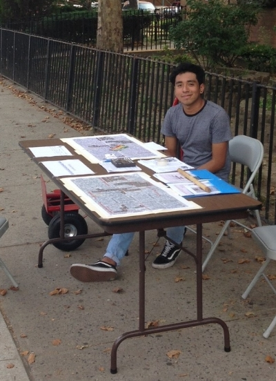 Daniel tabling in front of 160 Menahan Street