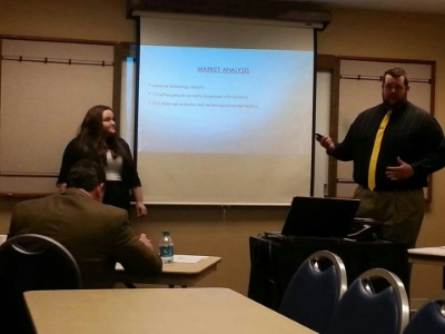 Jamee and Payden presenting Read 'n Style (later known as Hidden Abilities) to the judge panel at the Mark L. Morris Business plan Competition.