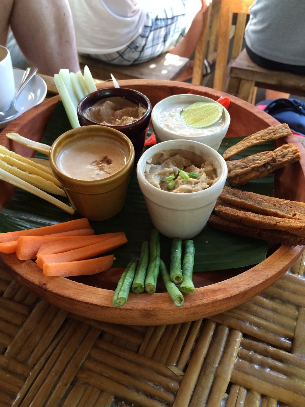 7 Veggie Dip - vegetables, tempeh and breadsticks with red curry, guacamole, white bean hummus and peanut sauces.