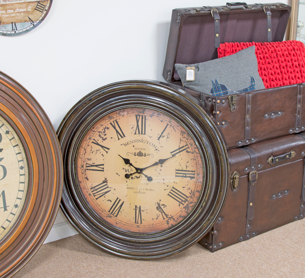 Clocks, trunks & cushions.