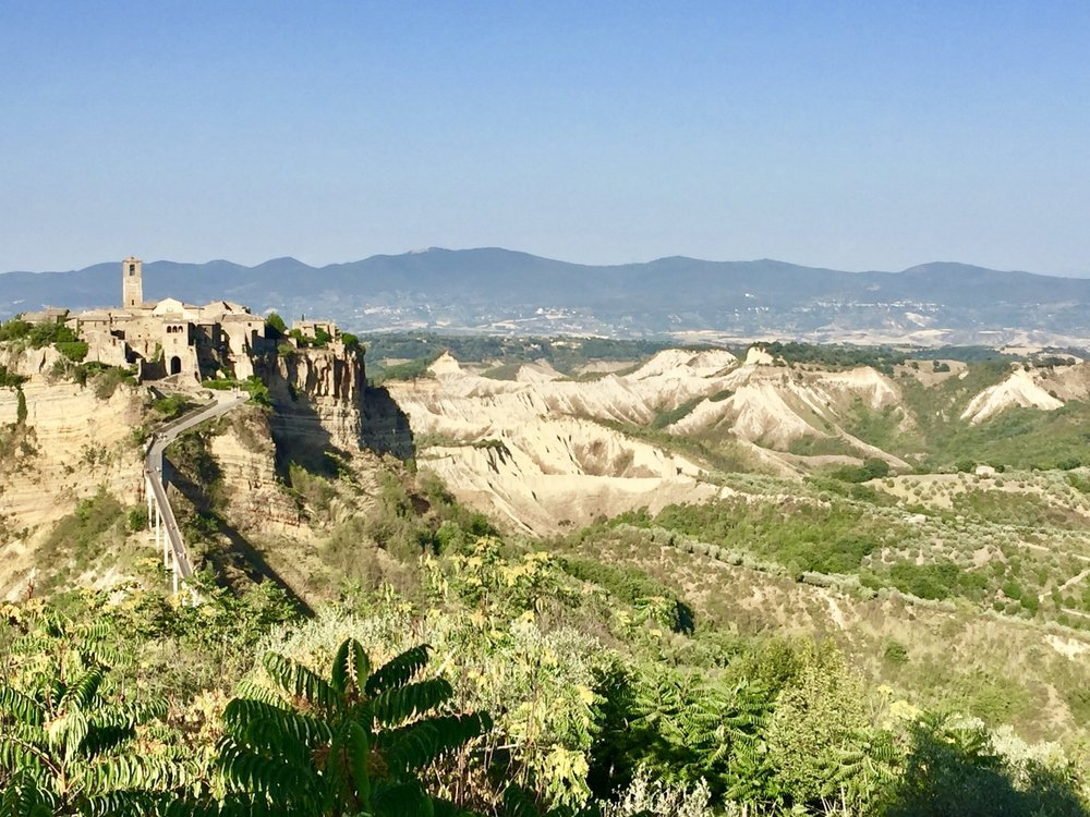Hike from Lubriano to Civita di Bagnoregio ends with stunning views of the fortress hill that once used to be a bustling fortress town but now imploding gradually into the Calanchi Valley (Photo credit: Sumilier)
