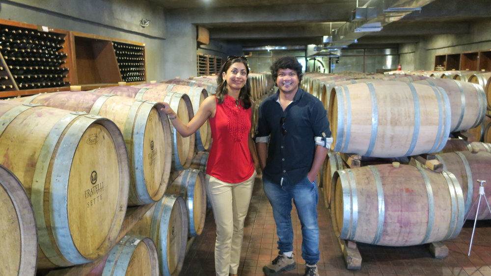 Sumi with Vrushal Kedari, winemaker of Fratelli in the barrel room below the Fratelli winery (Photo credit: Sumi Sarma)