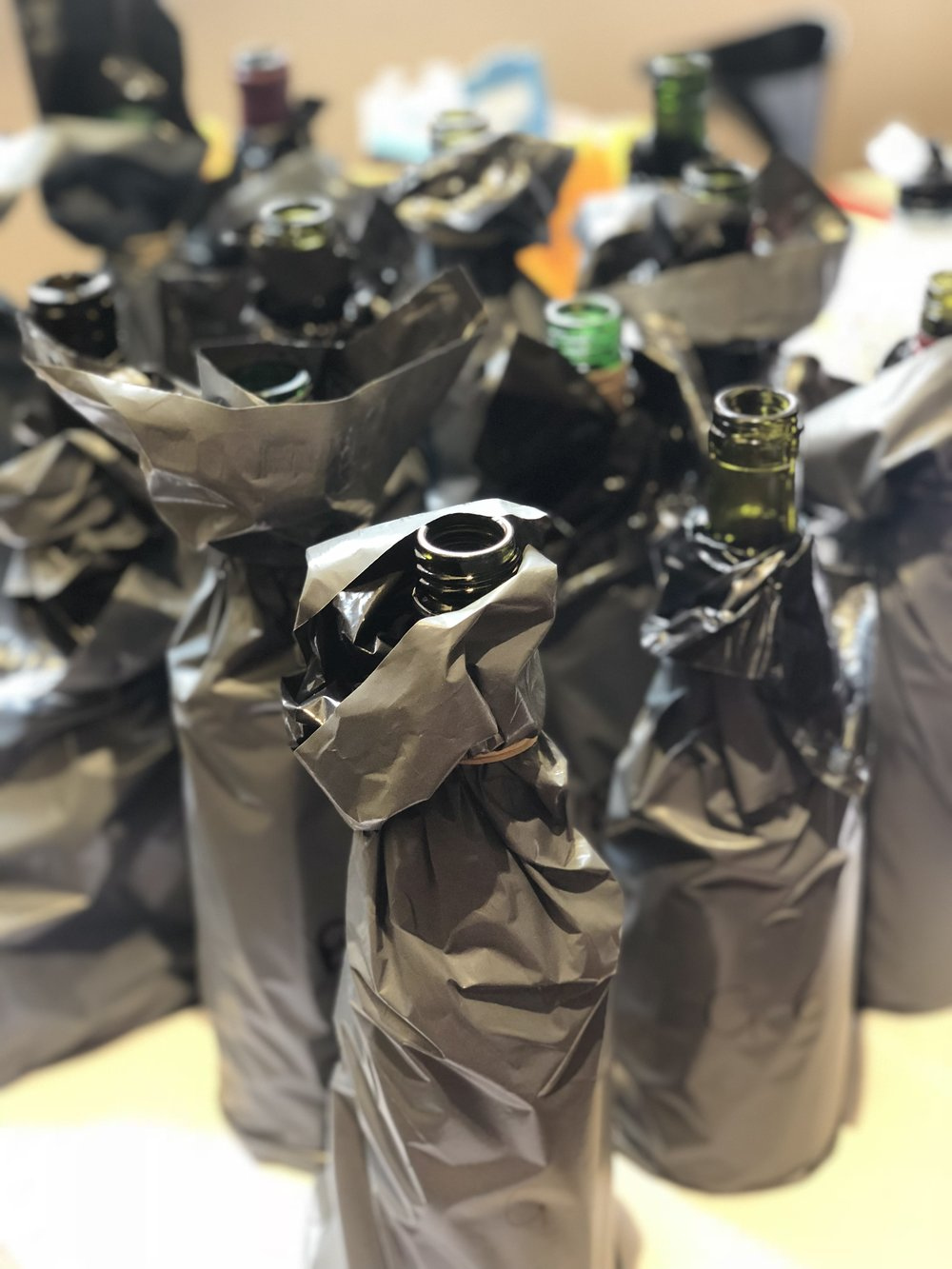 Blind Tasting set up for People's Choice Wine Awards all crisp and covered in black (Image: Sumi Sarma)