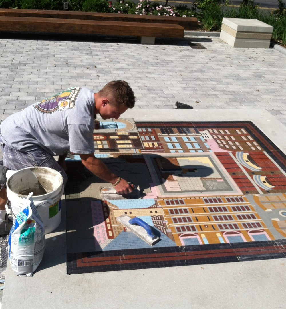 Dan Sacco installing the mosaic in Iron Street Park, Boston