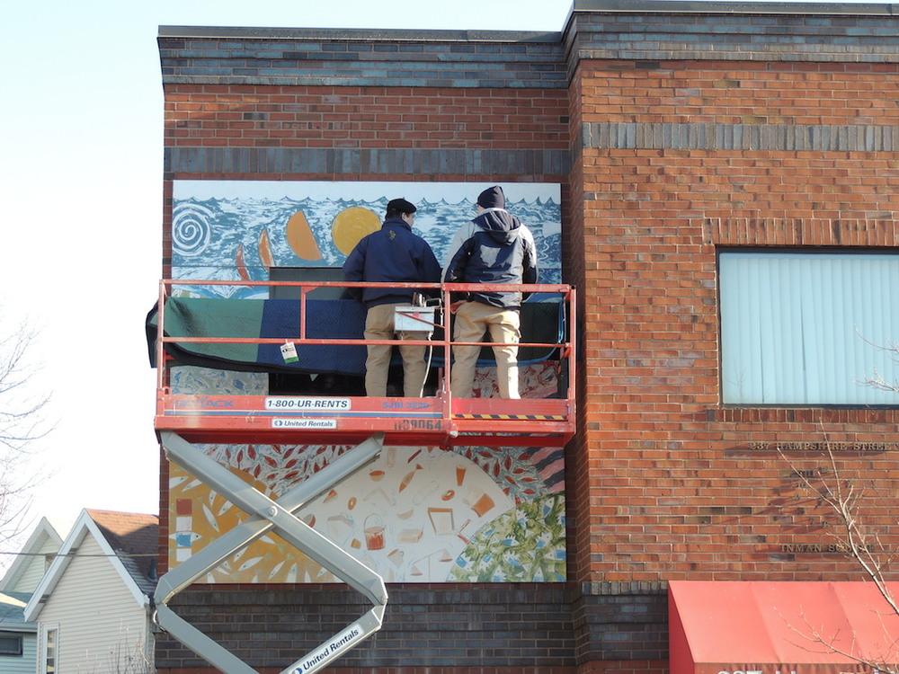 George Hagerty and Alfred Zuniga removing aluminum panels from Inman Square building