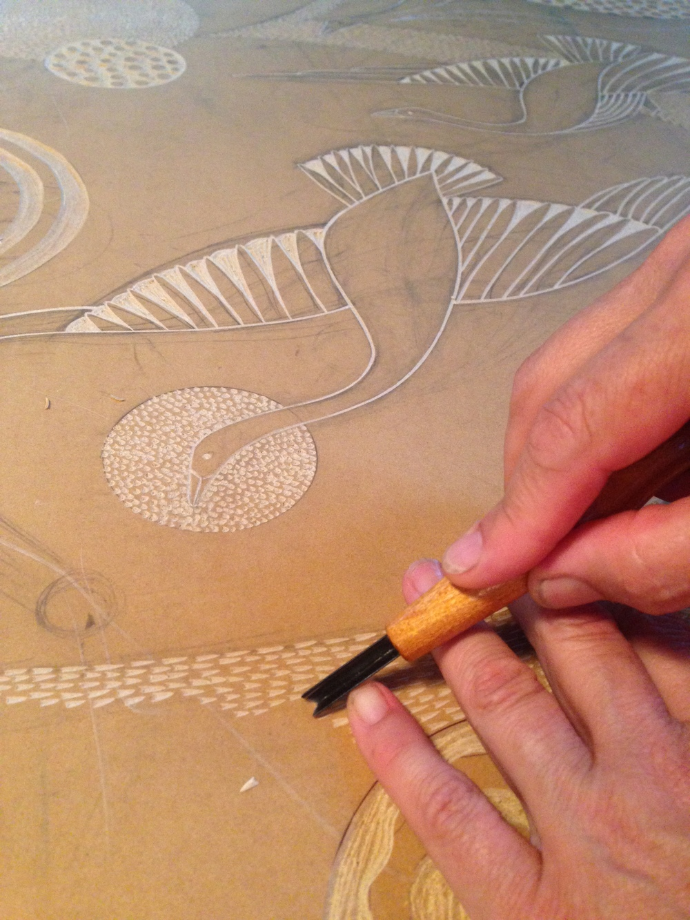 carving the linoleum for Swooping and Swirling