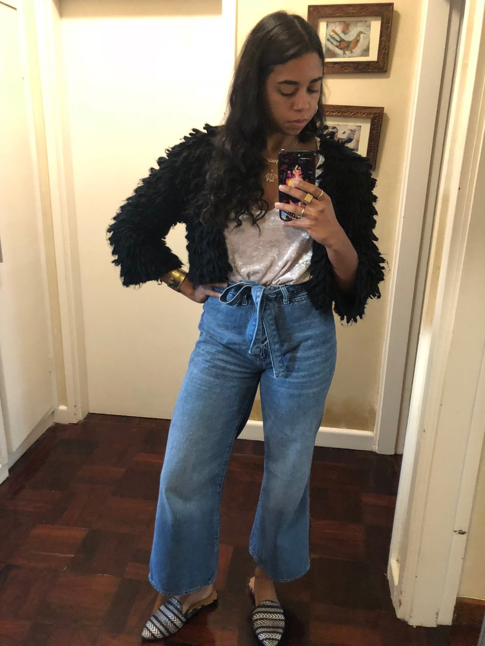 I love the ease of this look, and the mixing of materials with the soft fringe and velvet of the shirt. The two colors are brought together in the flats, and the flare of the jeans keeps it light and great for the daytime, this was favorite day to night look.