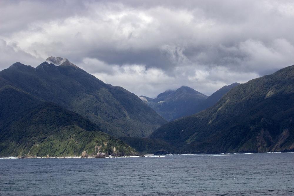 Moody mountains of the Fiordland coastline. South Island, New Zealand.
