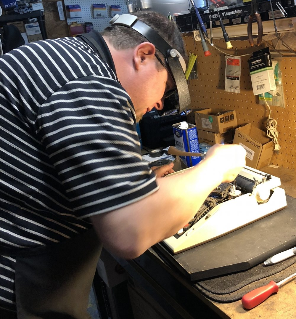 Our knowledgeable technician working on a typewriter repair.